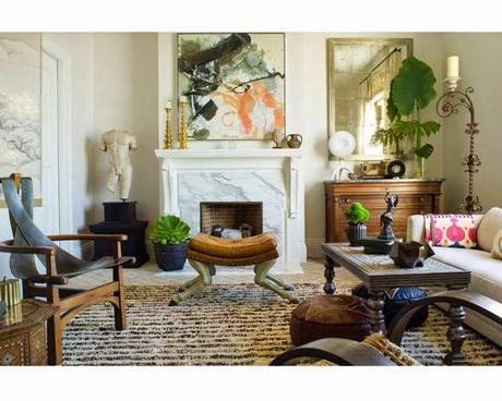 traditional neutral family room with pops of color in modern abstract art