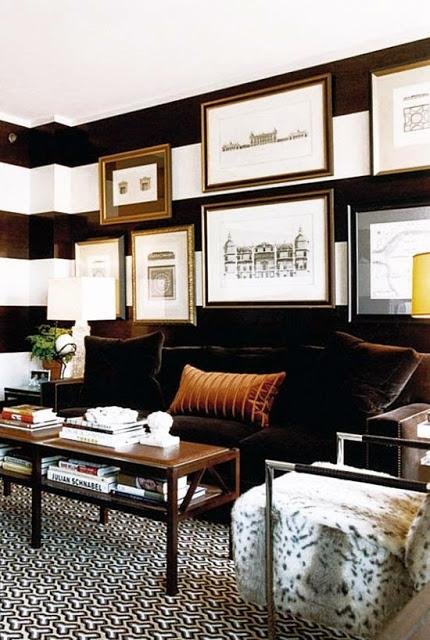black and white striped walls in living room gallery wall