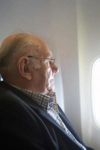 Man looking outside plane window