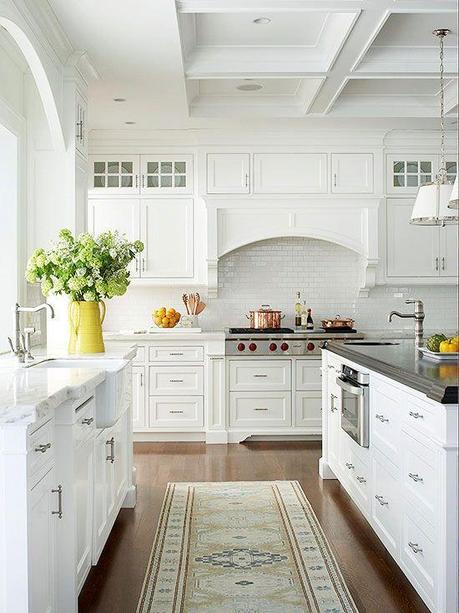 This traditional, cottage-style kitchen is spacious, light, and airy with its all-white color palette. Custom cabinetry, Carrara marble peri...