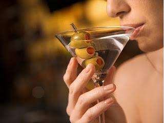 Heavy Drinking Impairs Serotonin Function More Rapidly in Women