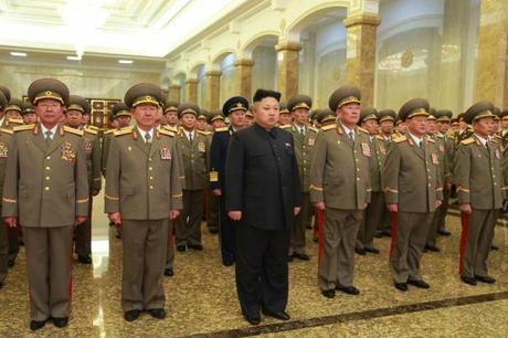 Kim Jong Un stands in the statue hall at Ku'msusan Memorial Palace of the Sun in Pyongyang around midnight on January 1, 2015 (Photo: Rodong Sinmun).
