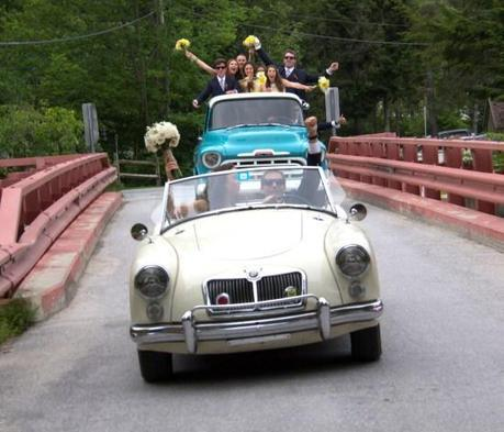 Driving Off In An MG And Turquoise Truck