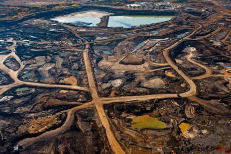 (Tar Sands' hellish landscape of ruined Earth and toxic tailing ponds. Image source Occupy.)