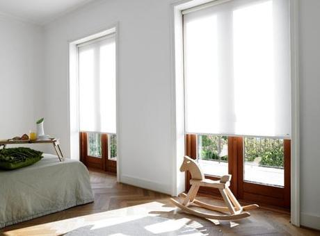 roller-shades-over-wood-french-windows