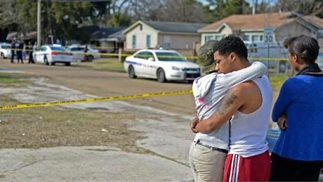 Advocate staff photo by HILARY SCHEINUK -- Two people console one another on the scene of a shooting death under investigation by Baton Rouge police the morning of Saturday, Jan. 10, 2015 at 4965 Jefferson Avenue near N. Foster Drive.
