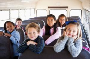 Children sitting inside school bus