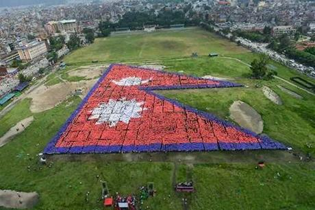 M and his friends took part in winning the world record for the largest human flag last summer!
