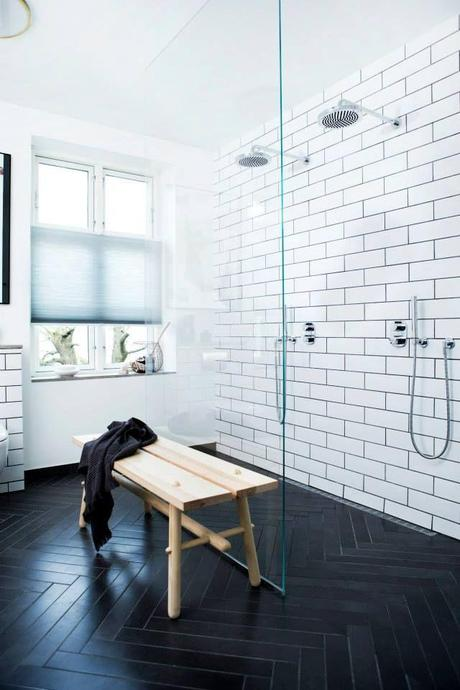 like subway tile with black herringbone floor