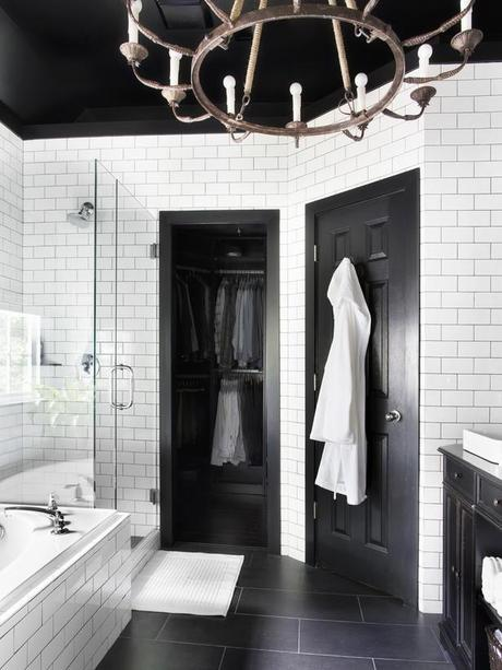 classic black and white; subway tile. Like the porcelain floors an clear glass shower. Brian Patrick Flynn
