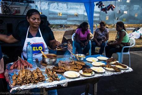 Locals sell foods all along the street during Carnival