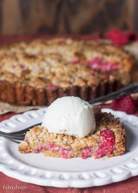 This Raspberry Coconut Crumble Tart has an almond coconut crust that doubles as a crumble topping, filled with fresh raspberries! This easy recipe is Paleo-friendly, gluten free, refined sugar free, and vegan.