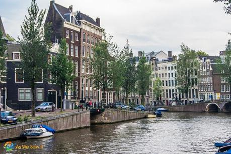crooked houses along a canal in Amterdam