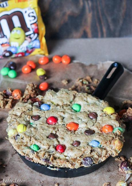 This Oatmeal M&M Peanut Butter Skillet Cookie is a quick and easy recipe made in one bowl that's perfect for sharing! It has a layer of peanut butter in the middle and lots of crispy edges. Top it with ice cream for a homemade version of the pizookie!