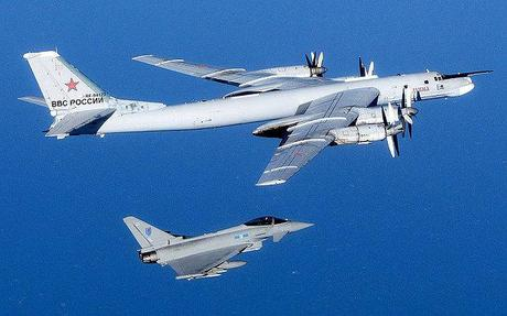 A British Royal Air Force (RAF) 6 Squadron Typhoon (bottom) intercepting a Russian Bear aircraft
