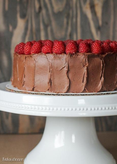 This Mocha Raspberry Cake has two layers of moist chocolate cake, a layer of sweet raspberry filling, frosted with a silky mocha buttercream and topped with fresh raspberries! This impressive cake is perfect for celebrating.