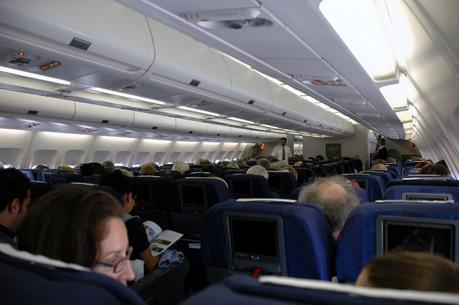 A full airplane makes staying healthy during air travel more difficult.
