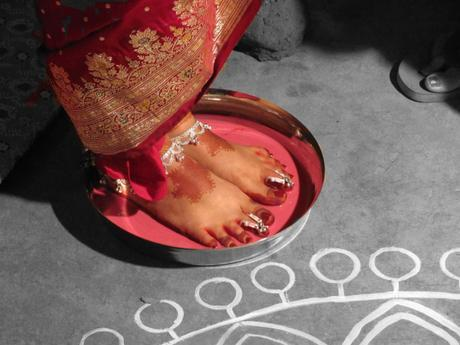An Indian bride arrives at her marital home. Photo credit: Shounak Ray on Flickr