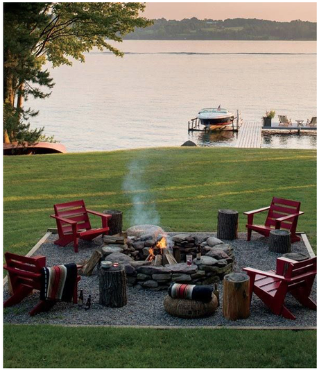 fireplace with red adirondack chairs backyard with beach