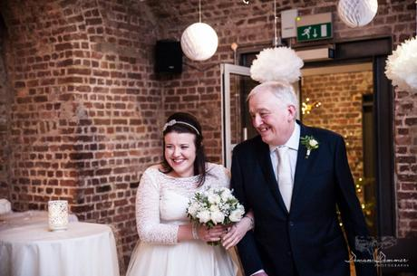 Bride and her father chatting