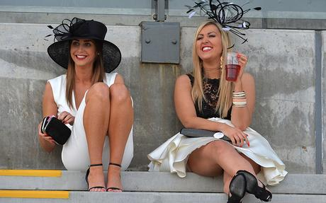 Two ladies take a seat to watch the races