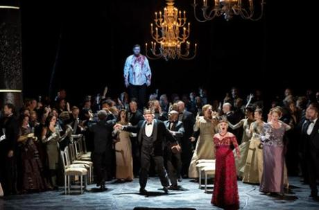 Banquo's ghost (Rene Pape) haunts Macbeth (Zeljko Lucic) as Lady Macbeth (Anna Netrebko) distracts the onlookers