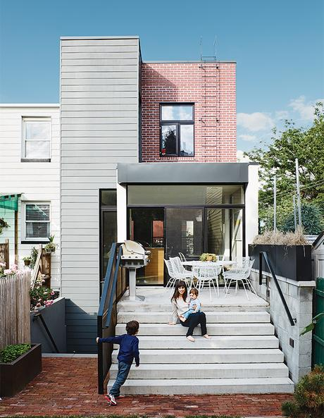 Modern Brooklyn renovation has floor to ceiling windows in dining room to patio