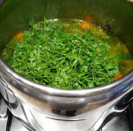 Adding fresh chervil before Vitamixing my soup!