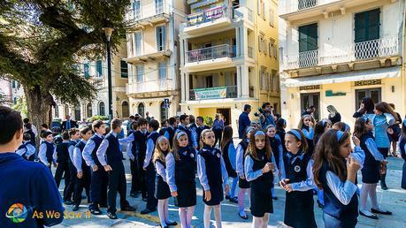 People prepare for the Ohi Day parade in Corfu