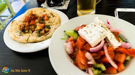 A big fat Greek salad, served with Greek bread and a glass of Mythos, the Greek beer