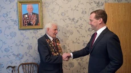 Prime Minister Dmitry Medvedev during a visit to veteran of the Great Patriotic War Ilya Kalashnikov Krasnoseltseva.