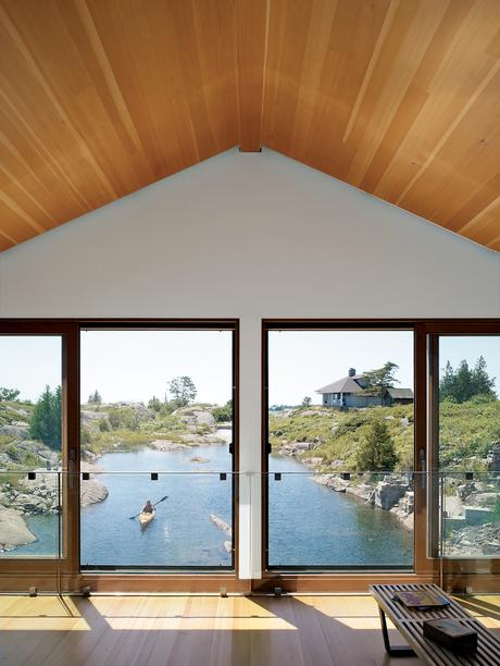 worple house floating house pitched roof windows lake