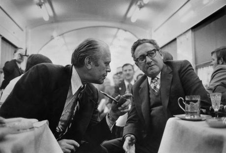 10 Jan 1974, Near Vladivostok, USSR --- In the dining car on the train from Vladivostok to the airport on November 23, 1974, President Gerald Ford discusses progress on the S.A.L.T. agreement with Secretary of State Henry Kissinger. President Ford and Kissinger spent two days in talks with Soviet leaders. --- Image by © Bettmann/CORBIS