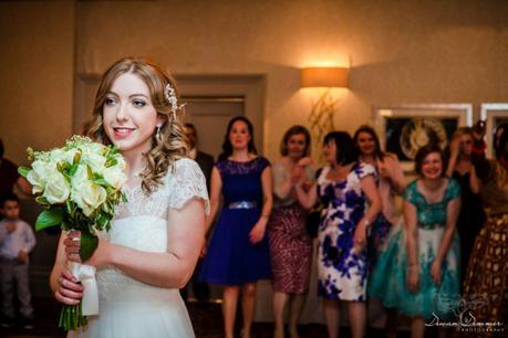 Bride prepares to toss bouquet