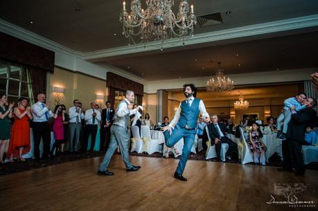 Groom and brother greek dancing at hendon hall hotel