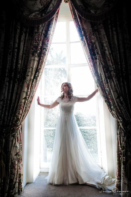 Bride-posed-by-window