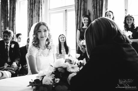 Brides smile at civil ceremony at hendon hall