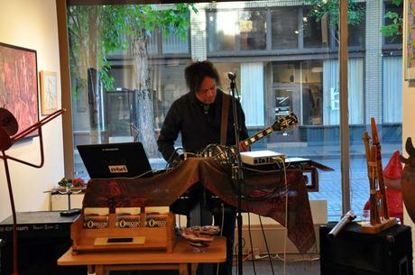 Multi-instrumentalist Tony Kalhagen performing during June 2015 First Thursday opening at Attic Gallery