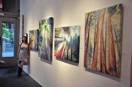 Portland, Oregon Artist Cedar Lee with her oil paintings of trees at Attic Gallery
