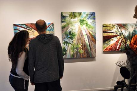 Art enthusiasts viewing paintings by Portland, Oregon artist Cedar Lee at Attic Gallery