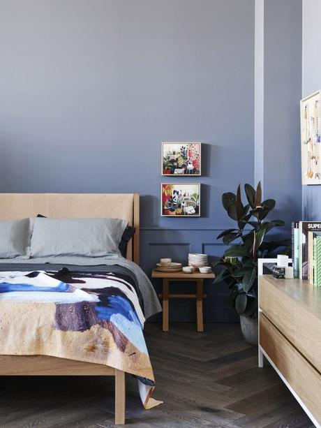 Bedroom details.   All furniture by Jardan. Paintings above right hand bedside by Elizabeth Barnett. Ceramics on bedside by Sarah Schembri. Artwork on right hand wall by Kirra Jamison.  Bedlinen by Frank and Mint, throw by Shilo Engelbrecht.  Flooring – French Grey Herringbone by Royal Oak Floors.  Wall colour – Dulux Mirage Blue. Photo – Eve Wilson.