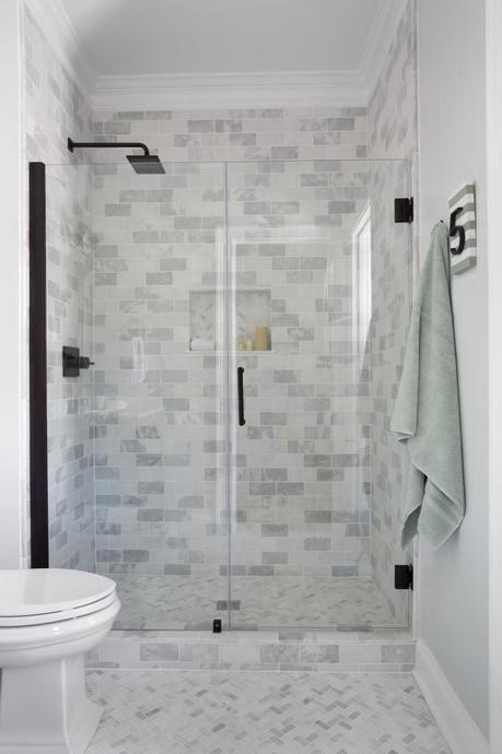 Bathroom using Cream Herringbone bathroom floor tile. https://www.pebbletileshop.com/products/Cream-Herringbone-Stone-Mosaic-Tile.html#.VVzyjflViko