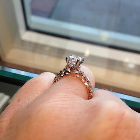 Solitaire engagement ring with rose gold side