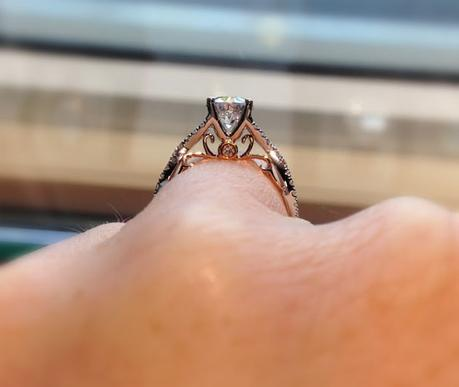 Solitaire engagement ring with rose gold underneath