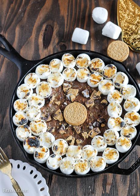 This S'mores Oreo Skillet Brownie has a graham cracker & S'mores Oreo crust with a gooey, fudgy brownie center and toasted marshmallows.
