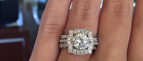 Round engagement ring with unique halo and three bands