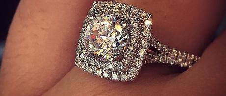 Cushion shaped double halo engagement ring