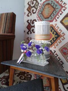 Vintage cruet with cornflowers.  Tuckshop Flowers Birmingham.  Weddings, funerals and events flowers to order.