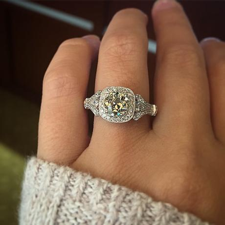 Antique style cushion engagement ring
