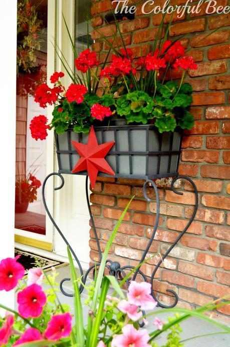 red geraniums and a red star for the entry on the 4th of July